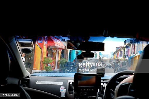 Driving in a taxi in little India Singapore