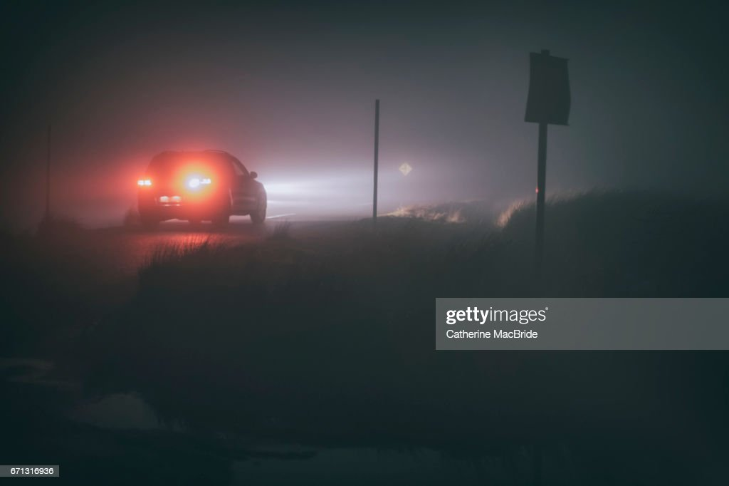 Driving in thick fog at night : Stock Photo
