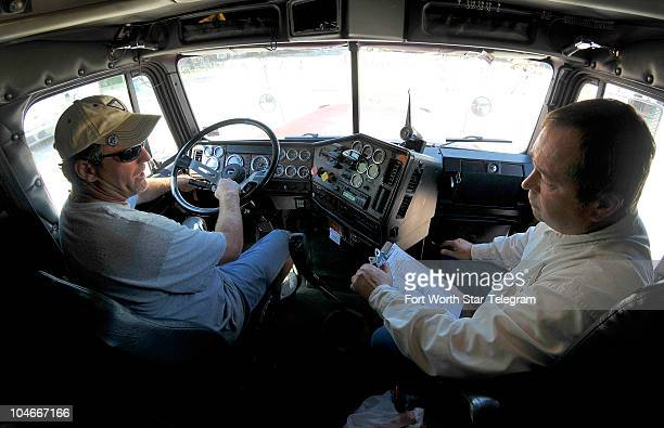Driving instructor Randy Bishop right watches as student driver Michael Brock goes through a predriving inspection on a semitruck on September 20 in...