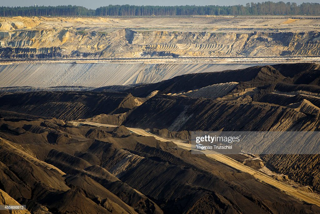 SUV driving on a street through spoil piles of the lignite opencast mining Welzow Sued which is operated by Vattenfall Europe Mining AG on September...