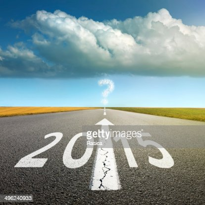 Driving on an empty asphalt road  forward to 2015 : Stock Photo