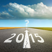 Driving on an empty asphalt road  forward to upcoming new year
