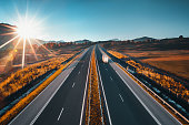 Driving on open road at beautiful sunny day. Aerial view of highway.