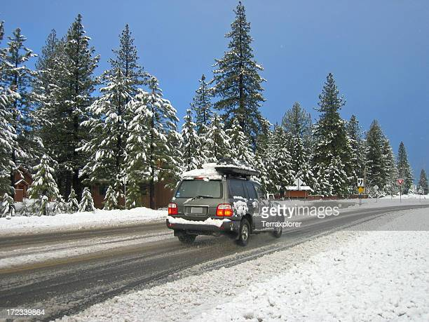 SUV Driving On Snowy Road