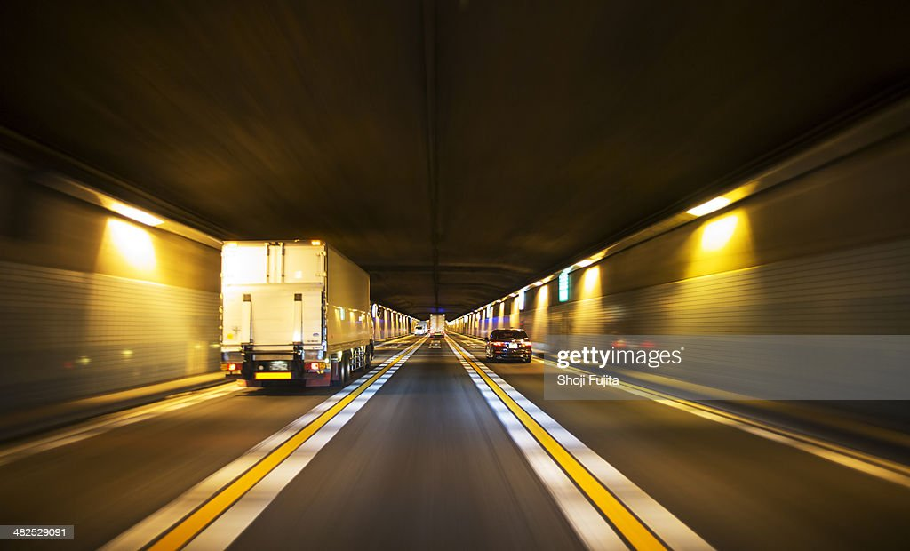 Driving through tunnel : Stock Photo