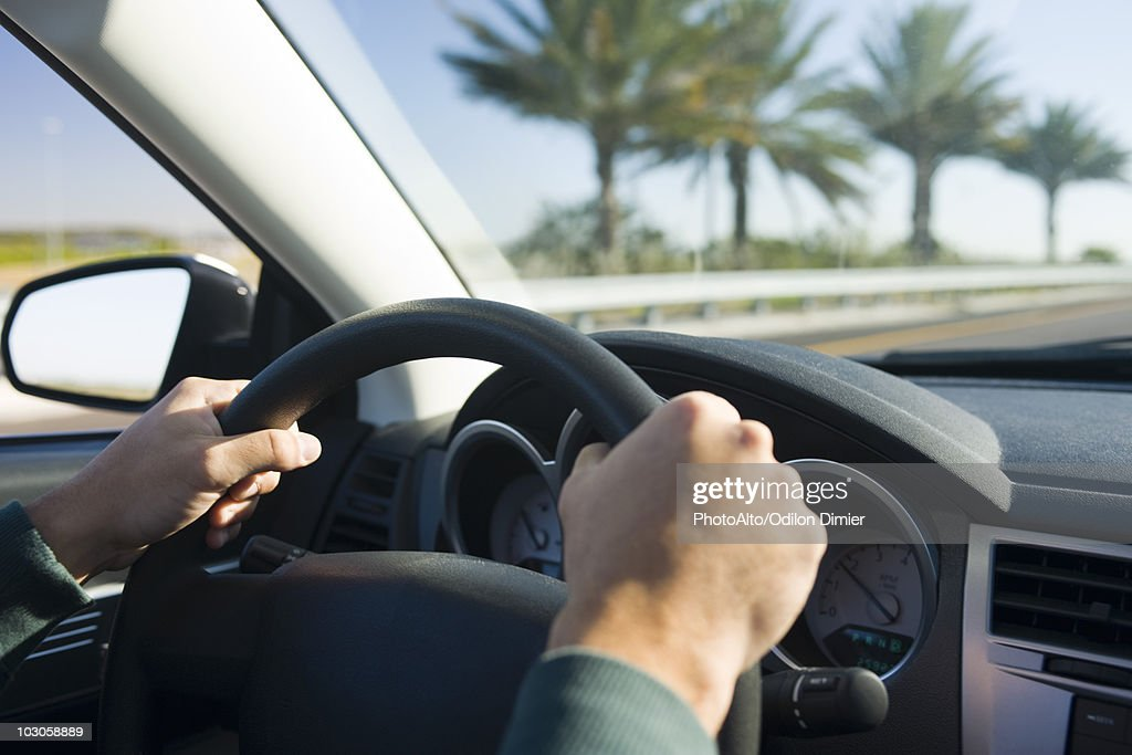 Driving With Both Hands On Steering Wheel Stock Photo