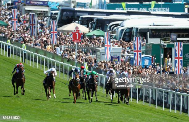 Drochaid ridden by Oisin Murphy wins the Investec Private Banking Handicap during the Investec Derby Day at Epsom Downs Racecourse on June 3 2017 in...
