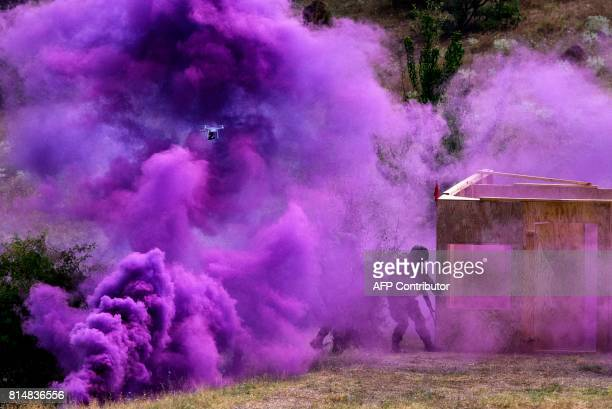 A drone and a violet smoke are seen as Bulgaria's soldiers take part in a joint military drill 'Peace Sentinel 2017' with US and Serbian army at...