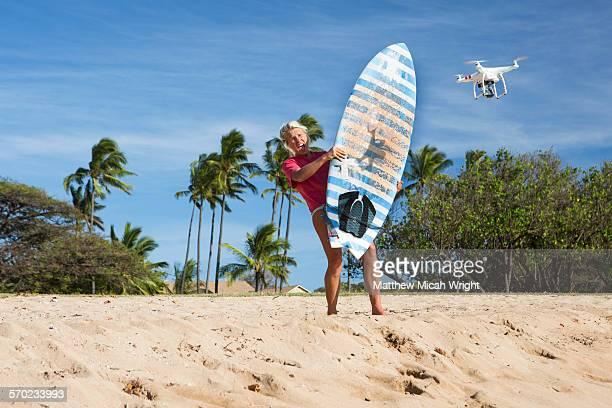 A drone attacks a surfer girl at public beach