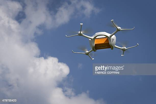 A drone carrying a mail box of Swiss Post is flying on July 7 2015 above the airport of Bellechasse western Switzerland during a press conference...