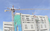 drone copter flying with digital camera.Drone with high resolution digital camera over construction site. video industrial inspection.Drone operated by worker on construction building