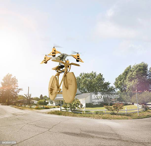 Drone delivering a bicycle in suburbia