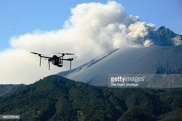 A drone flies around the crator of Sakurajima active volcano during a test on December 9 2014 in Kagoshima Japan The test continues until December 11...