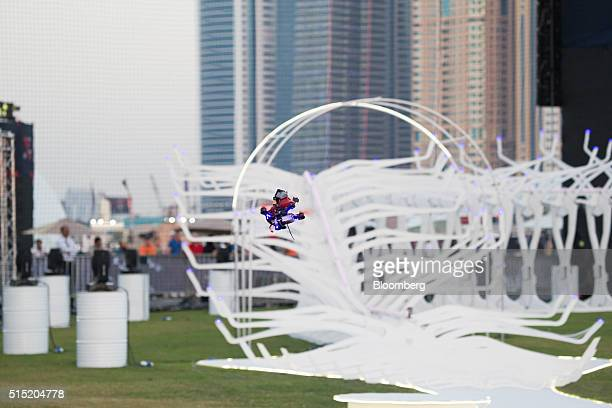A drone flies around the track in front of the Dubai's Marina skyline during the World Drone Prix drone racing championship in Dubai United Arab...