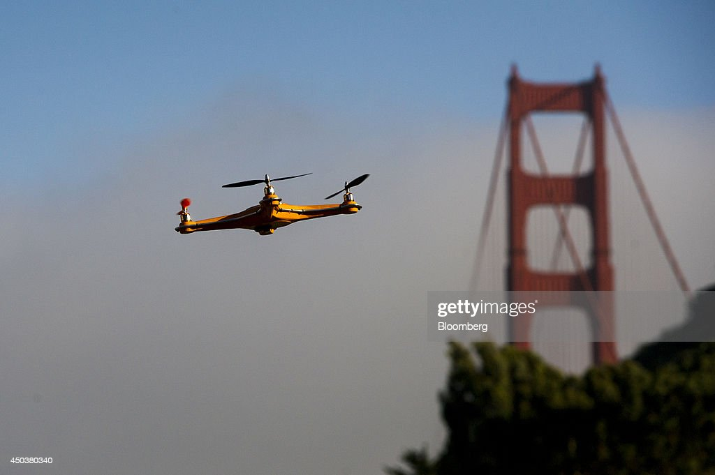 A drone flies in front of the Golden Gate Bridge during a demonstration at the Bloomberg Next Big Thing Summit in Sausalito, California, U.S., on Monday, June 9, 2014. The conference convenes tech's most important entrepreneurs, investors, and innovators for a discussion about what makes great tech leaders, successful companies, and disruptive products. Photographer: David Paul Morris/Bloomberg via Getty Images