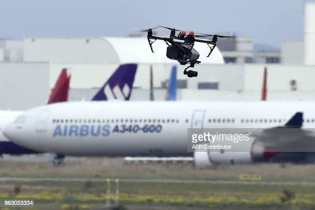 A drone flies on October 19 at the ToulouseBlagnac airport near Toulouse / AFP PHOTO / PASCAL PAVANI