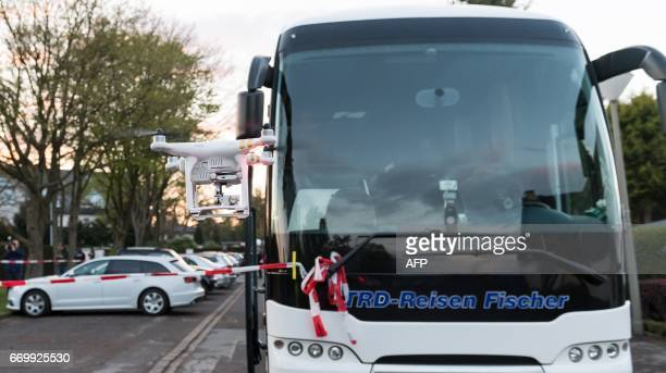 A drone flies over the replacement bus during the reconstruction of the attack on Borussia Dortmund football team's bus in Dortmund western Germany...