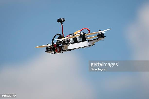 A drone flies through the sky during practice day at the National Drone Racing Championships on Governors Island August 5 2016 in New York City More...