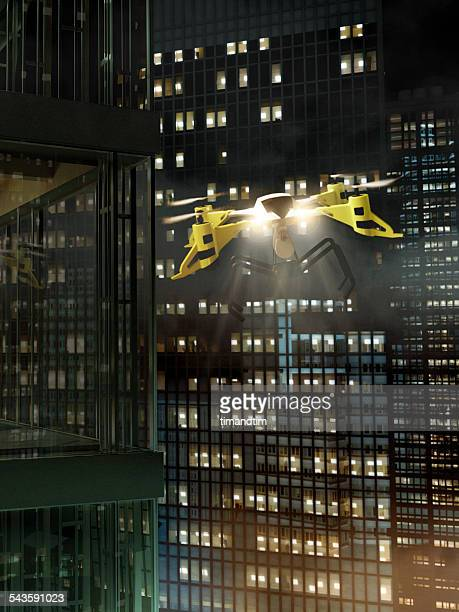 Drone flying among skyscrapers at night