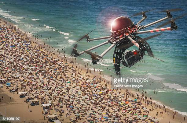 Drone flying and filming over a crowded beach