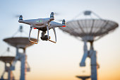 Drone flying at the Satellite antenna array