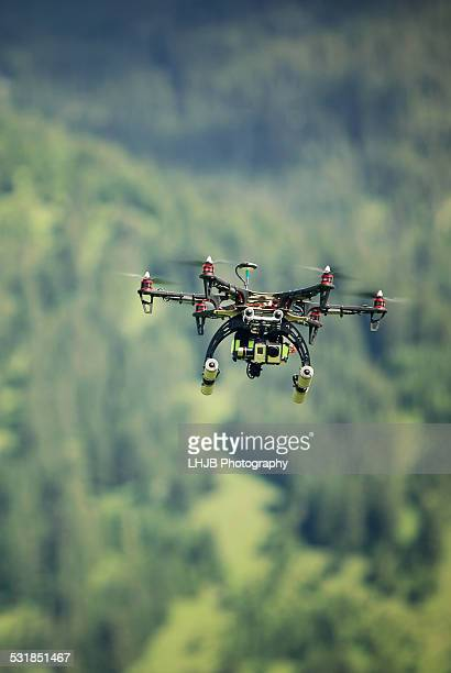 Drone flying in green area