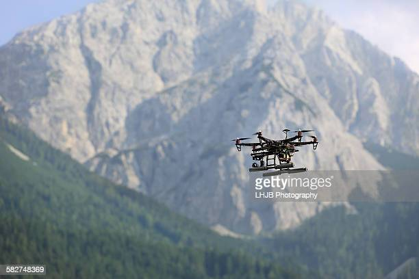 Drone flying in mountain area with trees, Austria