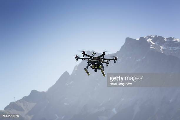 Drone flying with camera in mountain area