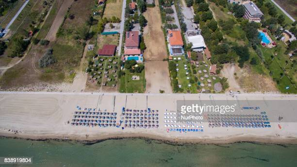 Drone images of Korinos Beach in Katerini in Northern Greece on 25 August 2017 with golden clean sand transparent green blue water and relaxed...