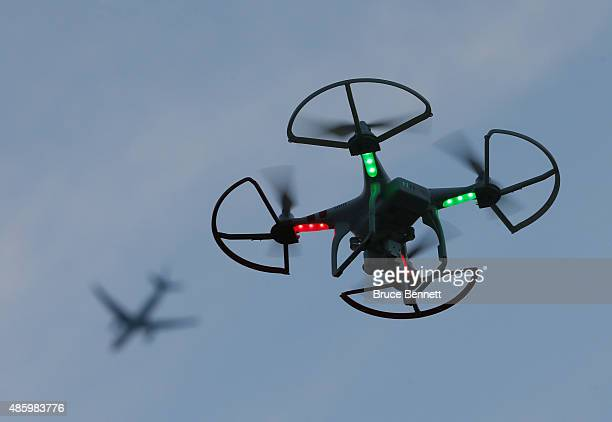 A drone is flown for recreational purposes as an airplane passes overhead in the skies above Old Bethpage New York on August 30 2015