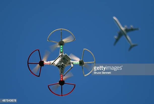 A drone is flown for recreational purposes as an airplane passes nearby in the sky above Old Bethpage New York on September 5 2015