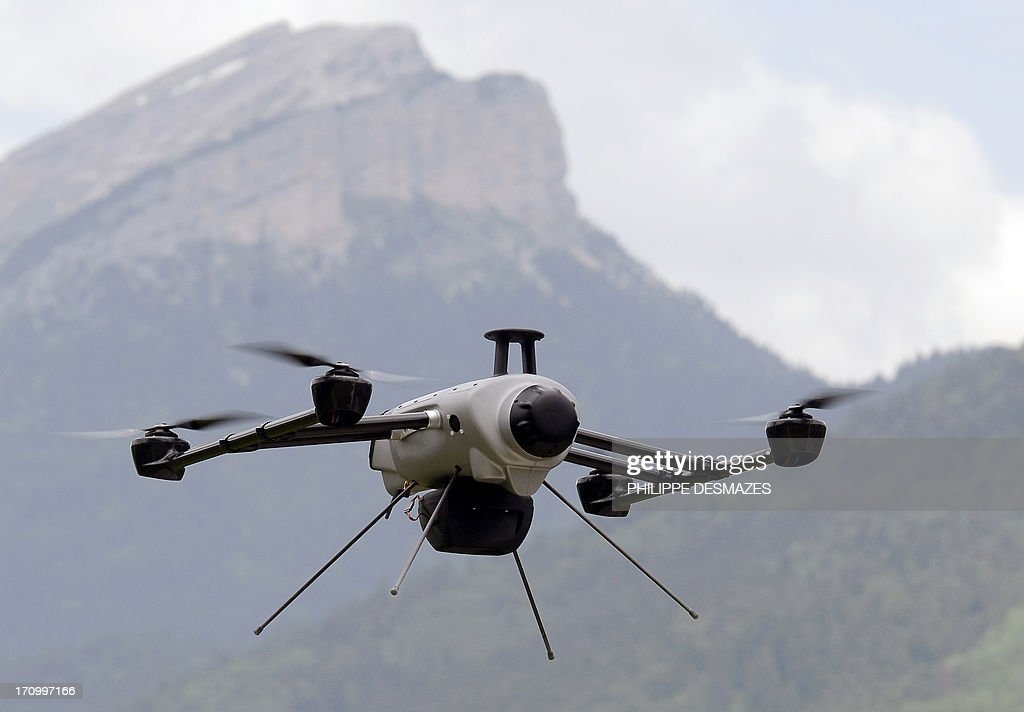 A drone of the Delta drone company flies over the Chartreuse Range as it is operated by an intern during a training session on June 20, 2013 in Quaix-en-Chartreuse near Grenoble, eastern France. Delta drone is one of France's leaders in the drone sector for civil purpose.