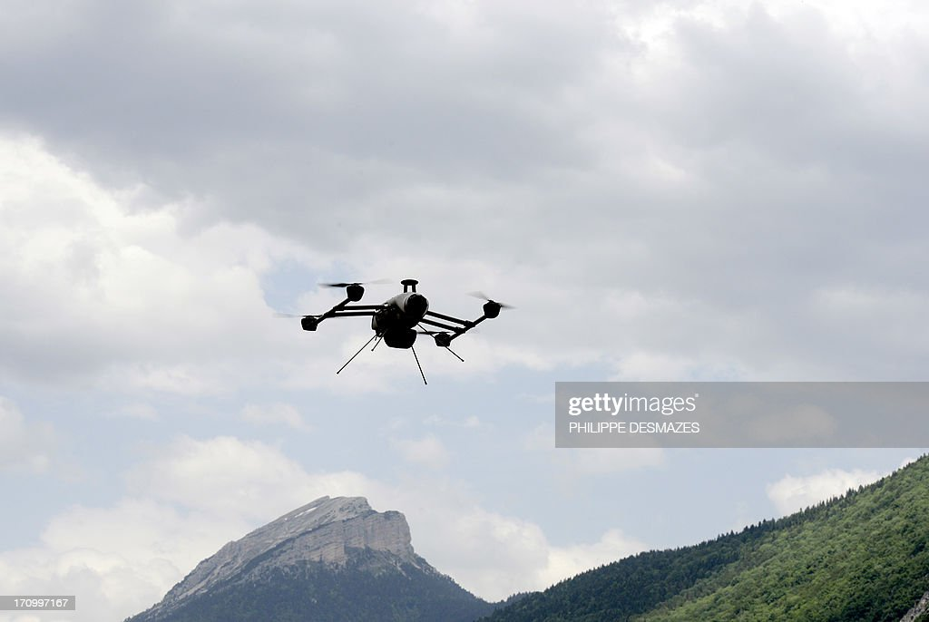 A drone of the Delta drone company flies over the Chartreuse Range as it is operated by an intern during a training session on June 20, 2013 in Quaix-en-Chartreuse near Grenoble, eastern France. Delta drone is one of France's leaders in the drone sector for civil purpose. AFP PHOTO/PHILIPPE DESMAZES
