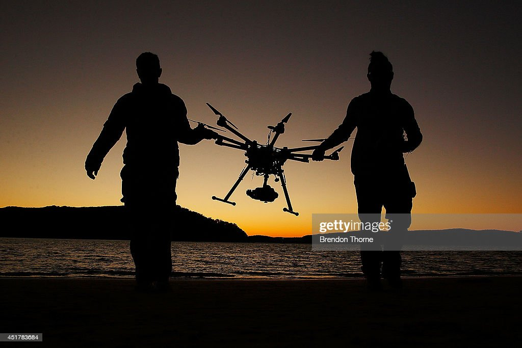 Drone operator, Ken Butti and Camera operator, Robbie Josephsen carry the custom built DJI s1000 Drone following a flight at Palm Beach on July 4, 2014 in Sydney, Australia. Commercial and recreational UAV (Unmanned Aerial Vehicles) sales in Australia have regulators concerned about safety, privacy and security, while the commercial industries of mining, farming, property, and sport are embracing the new technology. Under the current CASA (Civil Aviation Safety Authority) regulations all unmanned aircraft weighing more than 2kg need to have a UAS operators certificate. Licensed operators are not allowed to fly above 400ft, not within 5km of an airfield boundary and can't fly within 30 metres of people not involved with the operation.