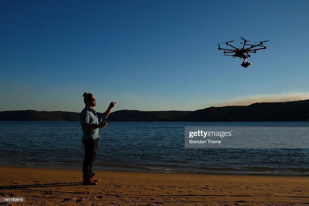 Drone operator, Ken Butti lands the custom built DJI s1000 Drone at Palm Beach on July 4, 2014 in Sydney, Australia. Commercial and recreational UAV (Unmanned Aerial Vehicles) sales in Australia have regulators concerned about safety, privacy and security, while the commercial industries of mining, farming, property, and sport are embracing the new technology. Under the current CASA (Civil Aviation Safety Authority) regulations all unmanned aircraft weighing more than 2kg need to have a UAS operators certificate. Licensed operators are not allowed to fly above 400ft, not within 5km of an airfield boundary and can't fly within 30 metres of people not involved with the operation.