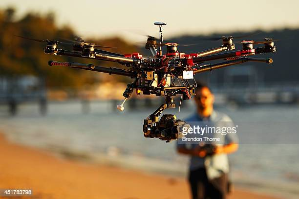 Drone operator Ken Butti lands the custom built DJI s1000 Drone at Palm Beach on July 4 2014 in Sydney Australia Commercial and recreational UAV...