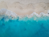 Drone photo of Grace Bay, Providenciales, Turks and Caicos. Only the caribbean blue sea and white sandy beaches can be seen