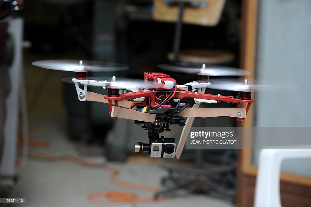 A drone prototype equiped with a GoPro camera is being tested at the headquarters of the start-up Squadrone System on July 2, 2014 in Saint-Martin d'Hères, centraleastern France. The Grenoble-based start-up Squadrone System launched a Kickstarter campaign for the HEXO+, a camera that needs no camera man and can fly and follow whatever target it is given. The campaign reached its $50,000 goal in just one hour, and in less than one day reached its $250,000 stretch goal, which means the company will include live view video feedback in its product.