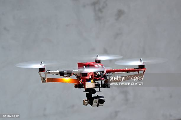 A drone prototype equiped with a GoPro camera is being tested at the headquarters of the startup Squadrone System on July 2 2014 in SaintMartin...