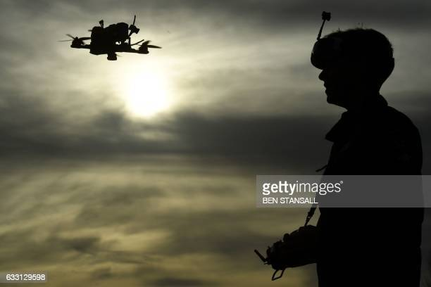 Drone racing champion Luke Bannister poses for a photograph as he flies his firstperson view drone in Wiltshire western England on December 22...