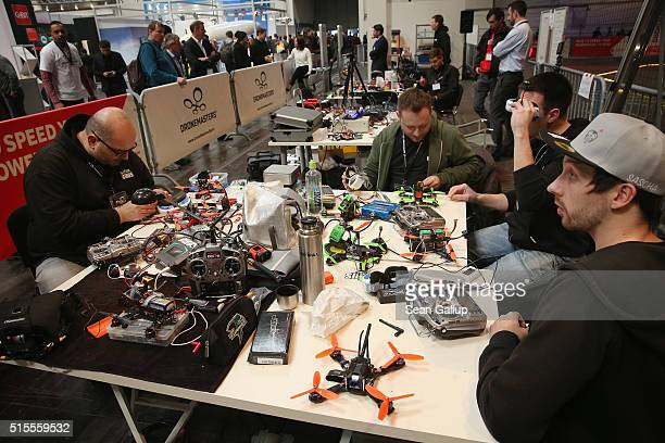 Drone racing enthusiasts prepare their equipment in the Dronemasters hall at the 2016 CeBIT digital technology trade fair on the fair's opening day...