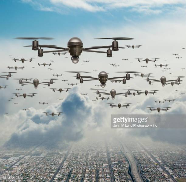 Drone surveillance planes flying over city