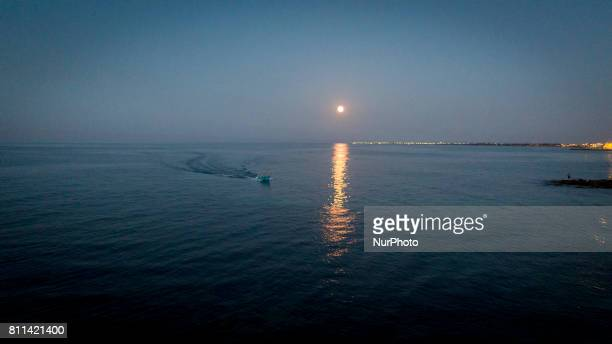 A drone view of fishermen during a sunset in Casalabate Italy on July 9 2017 Casalabate is a town on the Adriatic coast in the province of Lecce It...