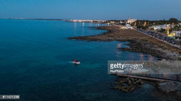 A drone view of people during a sunset in Casalabate Italy on July 9 2017 Casalabate is a town on the Adriatic coast in the province of Lecce It is a...