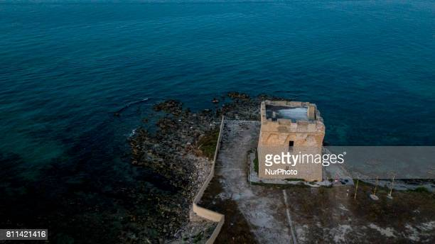 A drone view of Torre Specchiolla during a sunset in Casalabate Italy on July 9 2017 Casalabate is a town on the Adriatic coast in the province of...