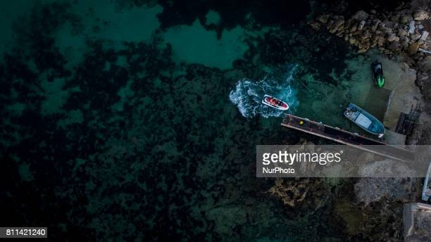 A drone view of watercraft and boat during a sunset in Casalabate Italy on July 9 2017 Casalabate is a town on the Adriatic coast in the province of...