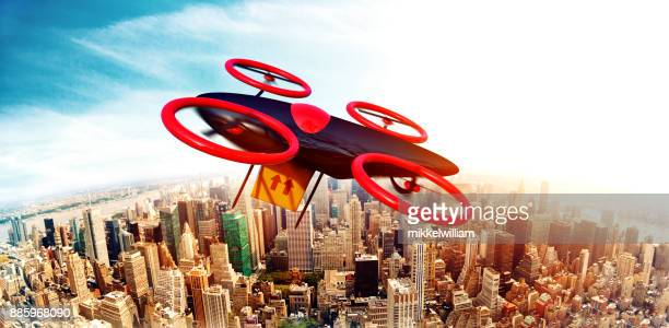 Drone with package is flying over smart city and gets ready to deliver shipment