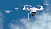 Drones fly in the sky