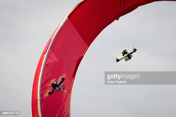 Drones fly through an obstacle course during practice day at the National Drone Racing Championships on Governors Island August 5 2016 in New York...