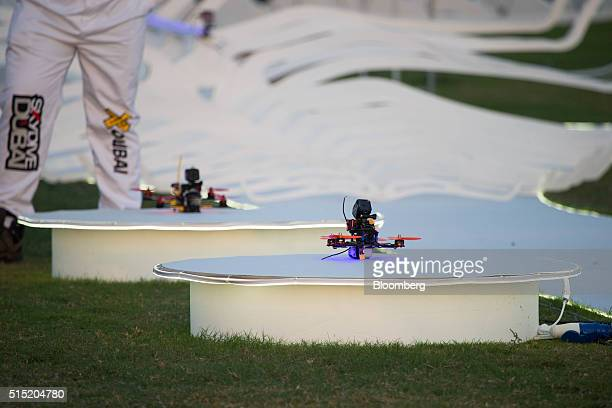 Drones sit on starting podiums during the quarterfinals at the World Drone Prix drone racing championship in Dubai United Arab Emirates on Saturday...